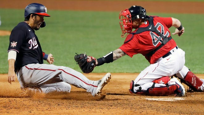 Red Sox catcher Christian Vazquez, right, tags out the Nationals' Kurt Suzuki at home plate during the fifth inning Saturday night at Fenway Park.