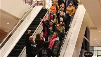 Protesters of the grand jury decision in the Michael Brown shooting chant slogans at the St. Louis Galleria mall on Wednesday evening, Nov. 26, 2014, in Richmond Heights, Mo. They stayed in the mall for about 15 minutes and then left peacefully without confrontation with a large police presence.