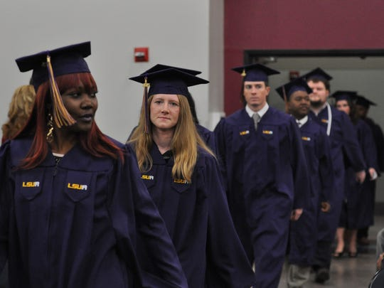 Louisiana State University of Alexandria graduates enter the Alexandria Riverfront Center for fall commencement Thursday.