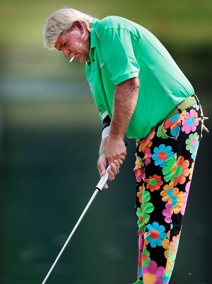 June 5, 2013 - John Daly putts on the 12th green during the Pro-Am at the FedEx St. Jude Classic Wednesday at Southwind.  (Jim Weber/The Commercial Appeal)