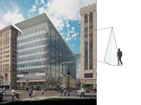 A rendering of the new Little Caesars headquarters building, featuring pizza-slice-shaped windows.