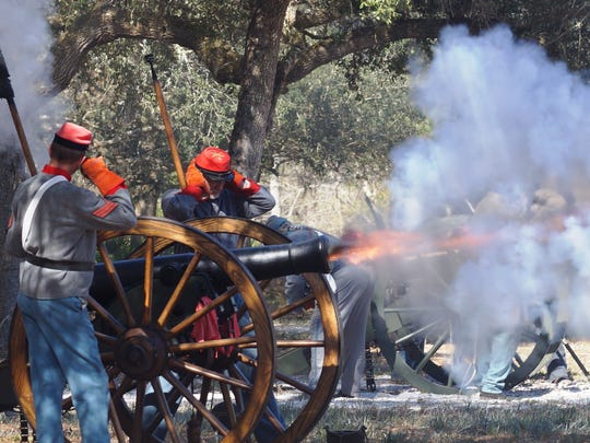 Mickey Cantner/Special to the Democrat Re-enactors fire a cannon blast at the Battle of Natural Bridge re-enactment. Reenactors fire a cannon blast at the Battle of Natural Bridge reenactment.