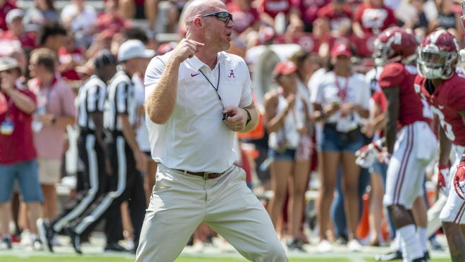 Alabama head strength and conditioning coach Scott Cochran leads warmups before an NCAA college football game against New Mexico State, Saturday, Sept. 7, 2019, in Tuscaloosa, Ala.