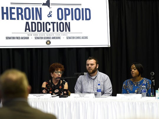 Panelists Penny Springfield, Jack Seman and Belinda Ellison share their personal stories during the NYS Senate Joint Task Force on Heroin and Opioid Addiction Forum at Binghamton University on February 6, 2018.