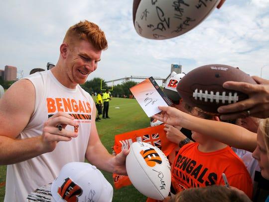 Cincinnati Bengals quarterback Andy Dalton (14) signs