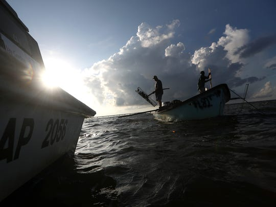 A scant few fishermen work the waters of the Apalachicola Bay for oysters, where only ten years ago hundreds of boats were found, these days about a dozen persistent oystermen remain.