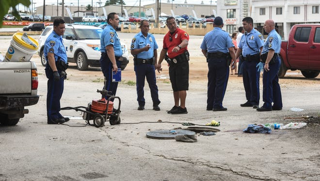 Guam Police Department officers investigate the fatal incident in Tamuning on Tuesday, Jan. 17, 2017 in this PDN file photo. A plumber's helper, employed by Inland Builders Corp., was found seriously injured while partially remaining in a manhole, by co-worker Johnny Teopaco. Teopaco said he had momentarily stepped away from the manhole.