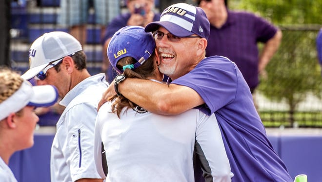 James Madison coach Mickey Dean hugs LSU coach Beth Torina after an NCAA college softball tournament super regional game in Harrisonburg, Va., Friday, May 27, 2016. (Austin Bachand/Daily News-Record via AP)
