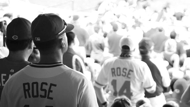 Fans in Pete Rose jerseys.