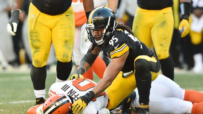 Pittsburgh Steelers outside linebacker Jarvis Jones (95) gets up after sacking Cleveland Browns quarterback Robert Griffin III (10) during the second half at Heinz Field. The Steelers won 27-24 in overtime.