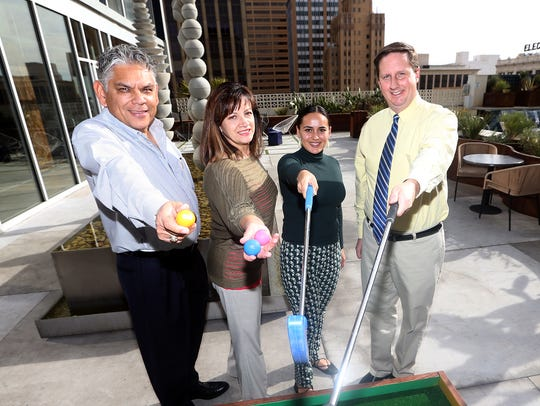 Joe Gudenrath, right, executive director of the Downtown Management District and other district employees will host the Downtown Barstool Open Jan. 27th. They are from left: Frank Hernandez, Terry Mais and Analissa Carreon.