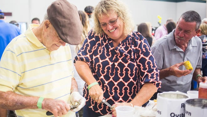 Bill Sanders, left, and Susan McLees, center, enjoy music while eating oysters in September at the Meals on Wheels Oyster Roast, Low Country Boil and BBQ fundraiser in Anderson.