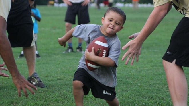 There was no age limit at the Springfield football camp Thursday night.