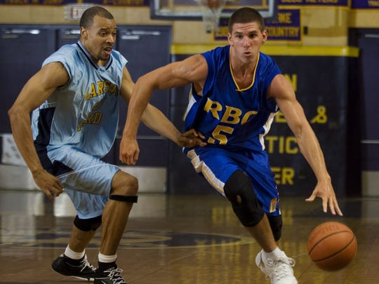 Jason Westrol (left) drives to the basket during a Jersey Shore Summer League game in 2008.