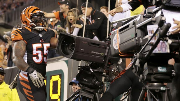 Cincinnati Bengals outside linebacker Vontaze Burfict (55) and free safety Reggie Nelson (20) crash into a broadcast camera, knocking it to the ground in the first quarter of the NFL Week 9 game between the Cincinnati Bengals and the Cleveland Browns at Paul Brown Stadium in downtown Cincinnati on Thursday, Nov. 5, 2015.