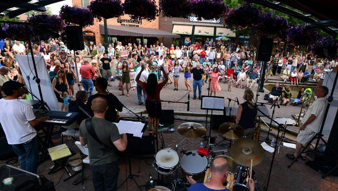 The crowd follows along as members of the Kizumba Salsa Band demonstrate a Latin dance on Thursday, June 13, 2013, during the Bohemian Nights Thursday Night Live concert series at the Old Town Square stage in Fort Collins.