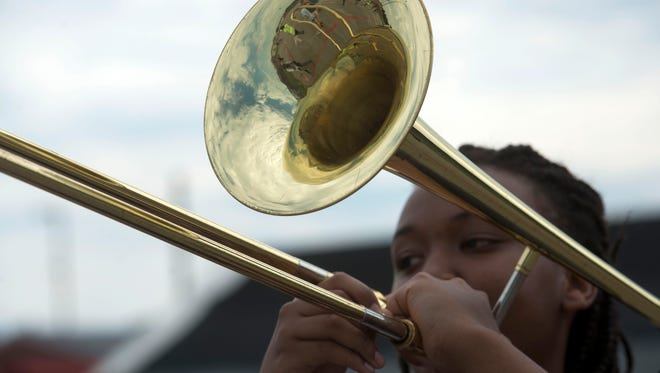 Destini Spears demonstrates the proper marching technique to a group of freshman at West Florida High School's summer band camp from freshman Thursday morning June 9, 2016.
