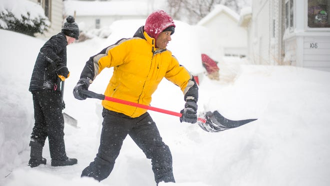 Vestal's Enoch Stephenson, 14, right, and Austin Clement, 14, shovel a driveway of a home along Charles Street in Vestal on Wednesday morning. The pair went door-to-door offering neighbors shoveling services.