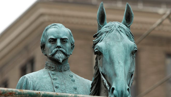 A monument to John Hunt Morgan, a Confederate General during the Civil War, stands near the old Historic Lexington Courthouse Aug. 14, 2017 in Lexington, Kentucky. The Mayor of Lexington, Jim Gray, announced plans to remove the statue, along with a statue of John C. Breckinridge which also stands at the courthouse, following the recent events in Charlottesville, Va.