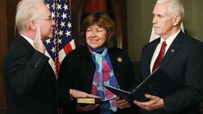 Betty Price (center) is pictured between Vice President Pence (right) and her husband Tom Price (left) as Tom Price gets sworn in as the Health and Human Services secretary earlier this year. Tom Price later resigned in wake of a travel spending scandal.