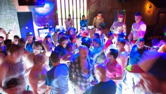 The light-up dance floor adds flavor to the club during a Phoenix Pride after party at Stacy's on Melrose on Saturday, April 11, 2015.