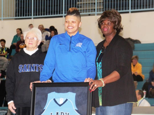 Sydney Moss with her framed jersey and grandmothers