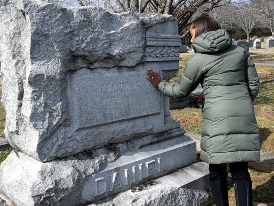 Fawn Weaver touches the gravestone of Jack Daniel in