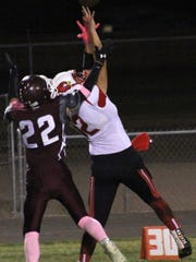 Eunice's Johan Juarez tries to catch a pass while being