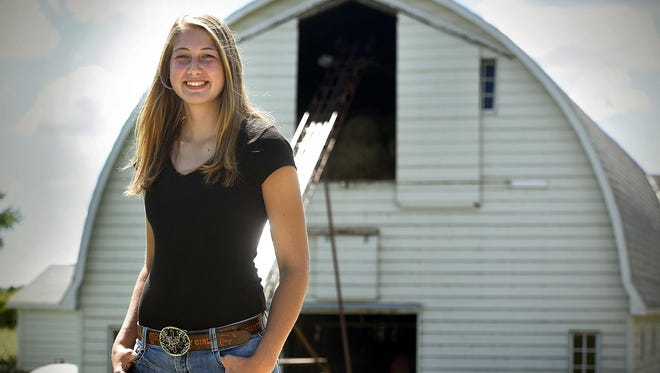 Princess Kay of the Milky Way finalist Morgan Uphoff smiles on her family farm Aug. 11 near New Munich/Melrose.