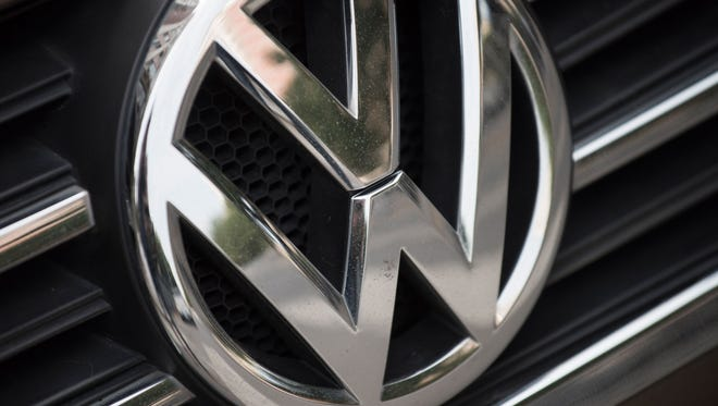 File photo taken in 2017 shows the Volkswagen logo on one of the German automaker's  cars in Beijing, China.