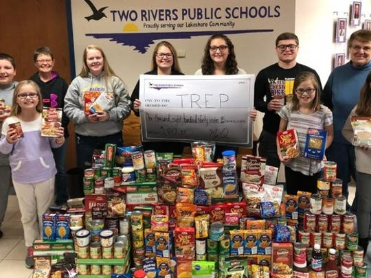 Two Rivers Public School District recently held a food drive for the Two Rivers Ecumenical Pantry. Pictured, from left, are front row, Madison Wester, fourth grade, Magee; Sophia Soukup, fourth grade, Koenig; and Mikayla Van Wychen, fourth grade, Magee; and back row, Jayden Wanek, fourth grade, Koenig; Lynn Skarvan, TREP; Megan Funk, senior, Two Rivers High School; Alazay DeGroot, eighth grade L.B. Clarke Middle School; Madison Loomans, eighth grade L.B. Clarke Middle School; Tommy Bianchi, senior, Two Rivers High School; and Sonja DeVore, TREP.