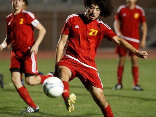 Palm Desert High School varsity soccer team, in red