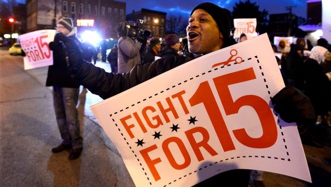 Demonstrations planned in 100 cities are part of push by labor unions, worker advocacy groups and Democrats to raise the federal minimum wage of $7.25, here in Chicago.