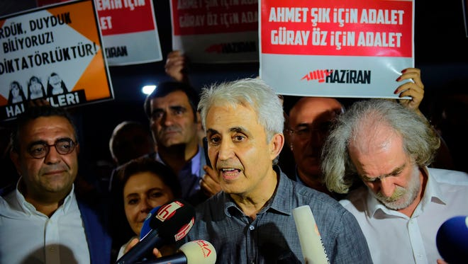 Turkish cartoonist Musa Kart of the 'Cumhuriyet' newspaper speaks to the press as he is welcomed by supporters after being freed from Silivri prison on July 28, 2017 following a Turkish court order.