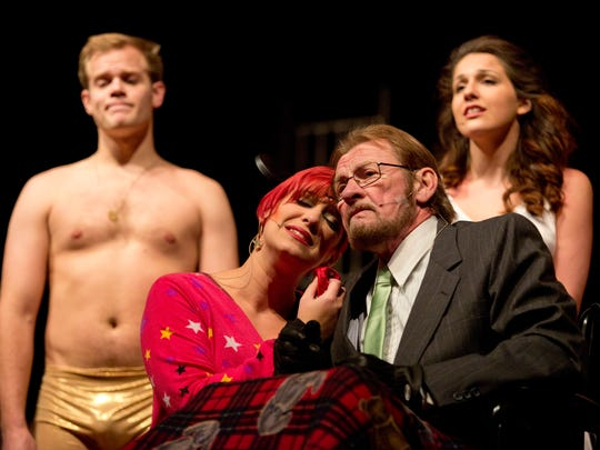 Cheryl McCoy performs as Columbia as Ray Kuznia performs as Dr. Scott during rehearsal for the Rocky Horror  Show Tuesday, Oct. 20, 2015, at McMorran Theater.