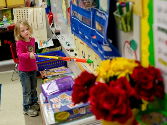 Kindergarten student Lilyann Jewell, 5, uses a pointer