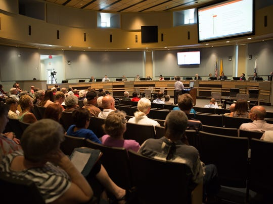 Las Cruces residents gather in City Hall for a meeting on Monday July 11, 2016 in which Las Cruces city councilors carry out a mid-year review of a citywide minimum wage hike.