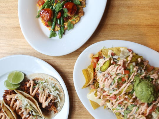 The chicken tinga tacos, chipotle agave glazed diver scallops and the drunken nachos at Malo on Wednesday, May 3, 2017, in Des Moines.