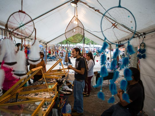 Artists and vendors sell Native American items during the 40th Nanticoke Powwow in Millsboro.