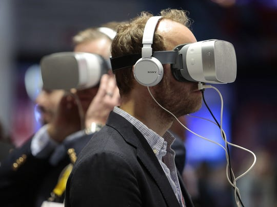 Visitors try out Virtual 5G technology during the Mobile World Congress on Feb. 27, 2018.