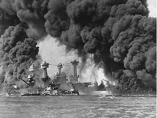 The battleships USS West Virginia and USS Tennessee appear after the Japanese attack on Pearl Harbor on Dec. 7, 1941.