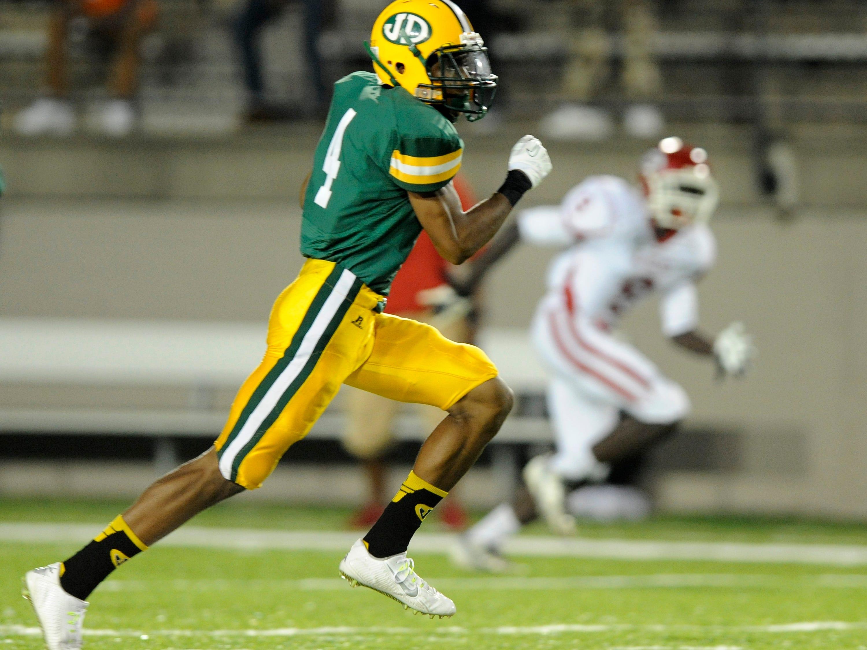 Zyon Gilbert of Jeff Davis returns an interception for a touchdown against Robert E. Lee at Cramton Bowl on Friday.