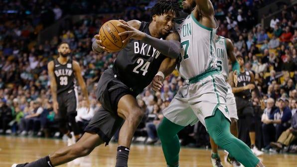 Brooklyn Nets forward Rondae Hollis-Jefferson (24) drives to the basket against Boston Celtics forward Semi Ojeleye (37) during the first half of an NBA basketball game Wednesday, April 11, 2018, in Boston. (AP Photo/Elise Amendola)