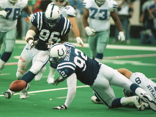 Colts defensive end Chad Bratzke (92) stretches for