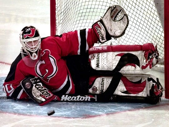 New Jersey Devils goalie Martin Brodeur drops to the