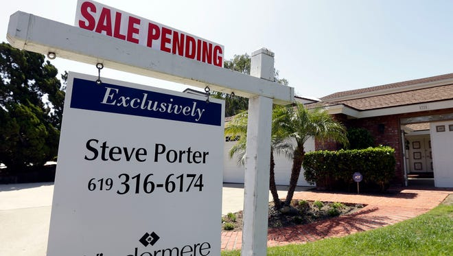 The National Association of Realtors say fewer Americans signed contracts to buy homes in August, the third straight monthly decline in its pending home sales index.