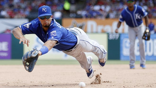 Kansas City Royals third baseman Cheslor Cuthbert, left, is unable to catch an RBI double hit by the Texas Rangers' Hanser Alberto during the seventh inning Sunday in Arlington, Texas.