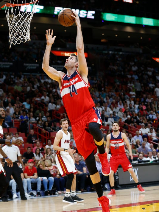 Washington Wizards forward Jason Smith takes a shot during the first half of an NBA basketball game against the Miami Heat, Wednesday, April 12, 2017, in Miami. (AP Photo/Wilfredo Lee)