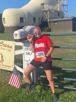 Mont Alto's Angie Fuss poses with her medal after completing the Shoe House 5-Miler in York. Fuss finished the race in 46:26.