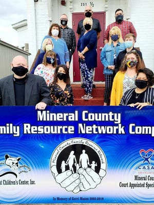 Members of the Mineral County Family Resource Network board of directors and staff are pictured with the new sign for the MCFRN complex: (front, l-r)  Andrew Root, Dayla Harvey, (left side) Gina Spriggs, April House, Patricia Barbarito, Patti Coleman and Chris Morgan; (center) Tom Denne and Patty Sites; (right) Sarah Burke, Wesley Stullenbarger, Barb Kesner and Eric Phillips. Not pictured: Autumn Beavers.